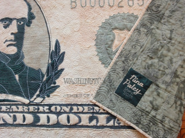 $10,000 quilt Nina Paley signature tag